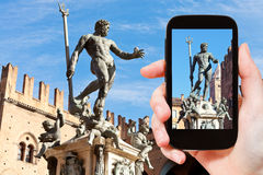 Tourist snapping photo of fountain of neptune Royalty Free Stock Photo