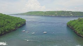 Tourist Snorkeling Boats Hidden Bay Nusa Penida Aerial 4k. Aerial footage of a beautiful snorkeling bay with shallow water in Nusa Penida, Indonesia stock video footage