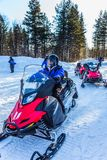 Tourist snowmobiles moves along the ice Stock Image