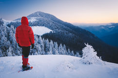 Tourist in snowshoes in the mountains Stock Photo