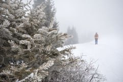 Tourist in the snowy mountains Stock Image