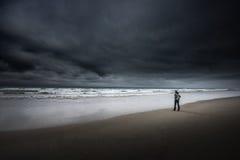 Tourist on South Jetty Beach Oregon Coast Dark Cloudy day Stock Photography
