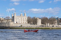 Tourist speed boat passes Tower of Londo. LONDON, UK - MARCH 25, 2016:  Tourist boat passes Tower of London Stock Photos