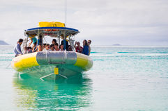 Tourist speed boat in turquoise waters Royalty Free Stock Photos