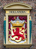 Arm of Coat and Hollandia Bas Relief Stock Image