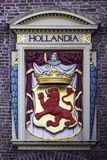 Arm of Coat and Hollandia Bas Relief Royalty Free Stock Images