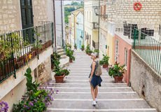 A tourist at stairway at the old town of Numana, Italy Stock Images