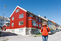 Tourist standing against multicolored houses Stock Photos