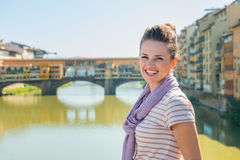 Tourist standing on the bridge overlooking Ponte Vecchio Stock Photos