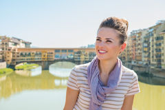 Tourist standing on the bridge overlooking Ponte Vecchio Royalty Free Stock Photo