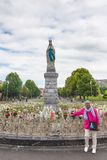 Tourist standing in front of  La Vierge Couronnee. LOURDES, FRANCE - JULY 23, 2014: A male tourist standing in front of  La Vierge Couronnee or Statue of the Royalty Free Stock Photography