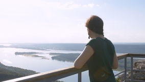 Tourist standing on the observation deck, enjoying the beautiful view of the Volga river. stock video footage