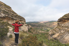 Tourist standing with outstretched arms and looking at the panoramic view in the majestic Golden Gate Highlands National Park, tra. Vel destination in South Stock Image