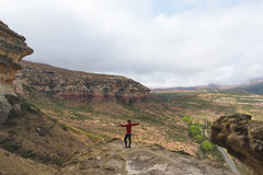 Tourist standing with outstretched arms and looking at the panoramic view in the majestic Golden Gate Highlands National Park, tra. Vel destination in South Stock Photo