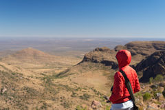 Tourist standing on rock and looking at the panoramic view in Marakele National Park, one of the travel destination in South Afric. A. Concept of adventure and Stock Photos
