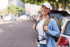 Tourist standing sidewalk. Beautiful tourist standing on the sidewalk of an urban street Stock Images