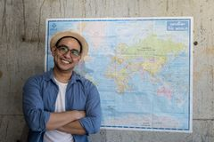 Tourist standing with worldmap on wall. Plans for next destination, lifestyle concept Stock Image