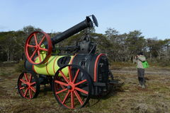Tourist at the steam threshers in Tierra del Fuego. royalty free stock photo