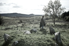Tourist at a stone circle in county Donegal Ireland royalty free stock image