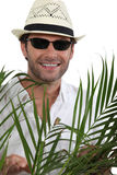 Tourist with straw hat Stock Image