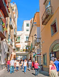 The tourist street. AMALFI, ITALY - OCTOBER 5, 2012: The daily walk at the medieval street is the popular time spending on mediterranean resort, on October 5 in Royalty Free Stock Images