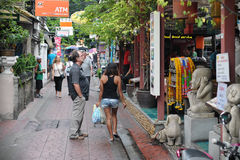 Tourist Street in Bangkok. Tourists walk along backpacker haven Ram Buttri Road on Aug 23, 2012 in Bangkok, Thailand. Budget accommodation on Ram Buttri Road Royalty Free Stock Images