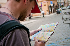 Tourist on the street looking at map Royalty Free Stock Photography
