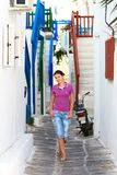 Tourist in a street of mykonos Stock Photos