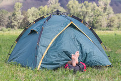 Tourist sleeping in a tent Royalty Free Stock Images