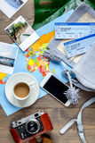 Tourist stuff with map and tickets on wooden background top view. Tourist stuff with worldwide map and flight tickets on wooden table background top view Royalty Free Stock Photo