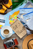 Tourist stuff with map and tickets on wooden background top view. Tourist stuff with worldwide map and flight tickets on wooden table background top view Stock Photo