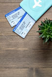 Tourist stuff with passport and tickets on wooden background top view mockup Royalty Free Stock Photo