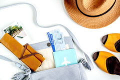 Tourist stuff with tickets and shoes on white background top view. Tourist stuff with flight tickets, hat and shoes on white table background top view Stock Images
