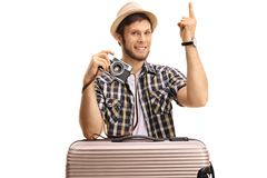 Tourist with a suitcase and a camera pointing up Stock Images