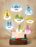 Tourist suitcase with famous landmarks around the world Stock Photo