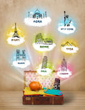 Tourist suitcase with famous landmarks around the world Stock Photography