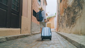 Tourist with a suitcase looking for accommodation place stock footage