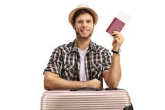 Tourist with a suitcase and a passport Royalty Free Stock Photo