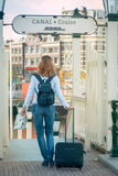 Tourist with a suitcase. Planning to take a canal cruise in Amsterdam Stock Photography
