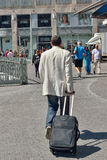 Tourist with suitcase on the way Stock Photography