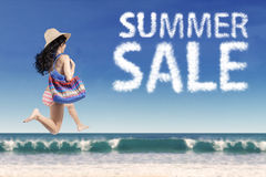 Tourist with summer sale cloud at beach Stock Photos