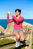 Tourist on summer travel taking photo Stock Photography