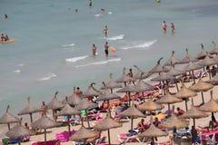 Tourist sunbathe or bath on the sea in El Arenal beach in Mallorca Royalty Free Stock Photos