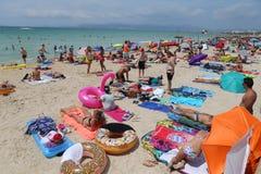 Tourist sunbathe or bath on the sea in El Arenal beach in Mallorca Stock Image
