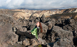 Tourist sunbathing on the lava field in Iceland Royalty Free Stock Images