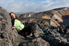 Tourist sunbathing on the lava field, Iceland Royalty Free Stock Photo