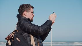 Tourist in sungasses films attractions on smartphone stock video footage
