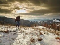 Tourist at sunset on mountain Stock Photos