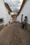 Tourist at sunset in a narrow alley of Cusco, Peru Royalty Free Stock Photos