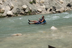 Tourist surfs the whitewater Royalty Free Stock Photo